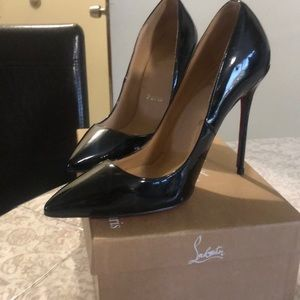 Pre loved Christian Louboutin shoes .
